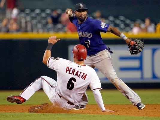 FILE - In this Sept. 29, 2015, file photo, Arizona Diamondbacks left fielder David Peralta (6) is forced out at second as Colorado Rockies shortstop Jose Reyes (7) turns a double play in the sixth inning of a baseball game in Phoenix. The New York Mets have signed Reyes to a minor league contract, Saturday, June 25, 2016.  Reyes, 33, played primarily at shortstop for the Mets from 2003-11, but may be used in a utility role in his reunion with the team. He was cut by Colorado after serving a 59-day suspension for violating Major League Baseball's domestic violence policy. (AP Photo/Matt York, File)