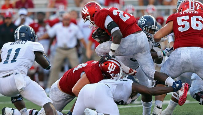 With a running style that exposes his legs less, Hoosiers running back Morgan Ellison leapt over defenders while carrying the ball against the Georgia Southern Eagles on Sept. 23 at Memorial Stadium. Mandatory. Ellison had suffered two broken legs in high school.
