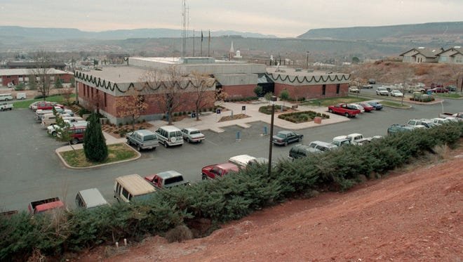 In December of 1994, Spectrum photographer Steve Coray captured the then image of the St. George City offices. The caption information written on the negative sleeve indicates that the city offices had outgrown the building at the time and in the ensuing years, they have indeed expanded the city's office space, first to the old Dixie College building on Main Street that has since become the St. George Children's Museum and later to the old Fifth District Courthouse Building to the east of the main city office building. The expansion of office space in St. George between 1994 and the present day is somewhat apparent as there are several multi-story office buildings that didn't exist in 1994 that can be seen throughout the now image. The three story office space and parking garage on Main Street, the office buildings directly south and west of the St. George City Offices and several other office buildings can be seen with a close inspection of the now image taken by Spectrum & Daily News photographer Jud Burkett.