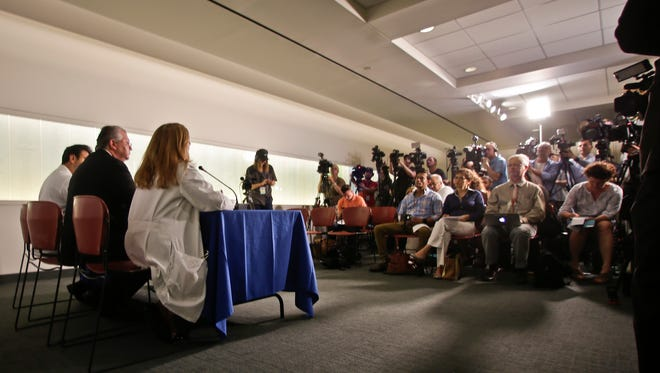 Doctors speak during a news conference at the Hackensack University Medical Center Wednesday. Doctors say a baby born to a mother with the Zika virus appears to be affected by the disease. Officials at Hackensack University Medical Center say the 31-year-old woman from Honduras delivered the baby girl through a cesarean section on Tuesday.