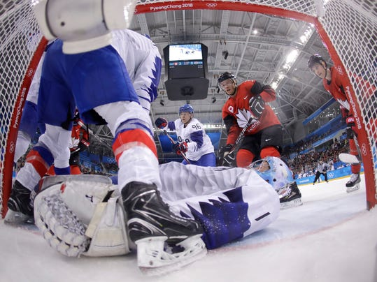 Goalie Matt Dalton (1), of South Korea, lays out to stop the puck during the third period of the preliminary round of the men's hockey game against Canada at the 2018 Winter Olympics in Gangneung, South Korea, Sunday, Feb. 18, 2018. (AP Photo/Julio Cortez, Pool)