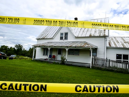Police tape surrounds a house on Airport Road in Berlin