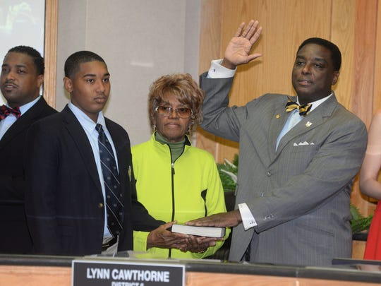 Lynn Cawthorne says the oath of office while being sworn in as a Caddo Commissioner.