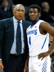 University of Memphis head coach Tubby Smith (left) chats with guard Keon Clergeot.