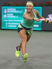 Elena Vesnina hits a shot during her win in the women's semifinal match over Kristina Mladenovic at the BNP Paribas Open, March 17, 2017.