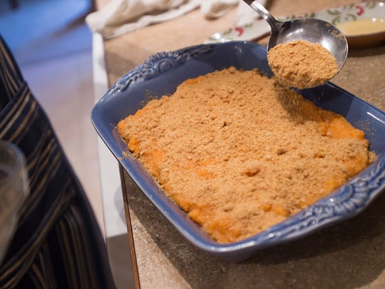Lisa Boesen prepares a sweet potato pone at her home