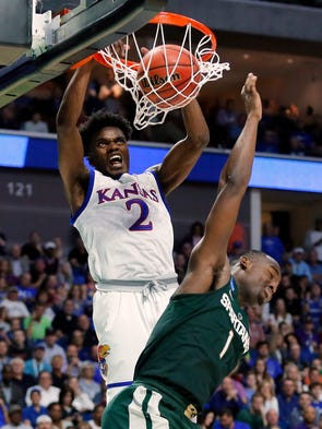 Kansas guard Lagerald Vick (2) dunks the ball over