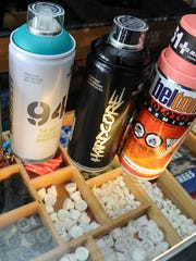 An assortment of water-based and acrylic brand spray paints and caps, that allow artists to paint broad or in detail, could be found at the Opake outlet, as seen on Friday, Aug. 19.