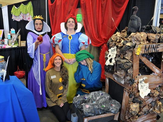 Sherryl Roberts, Judy Morgan, Katie Spence and Heather Santana of Workforce Solutions chose the story of Snow White and the Seven Dwarfs for their booth at the Wichita Falls Chamber of Commerce Business Expo Thursday at the Ray Clymer Exhibit Hall.