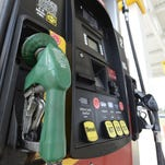 Gas prices continued to plummet Monday in Acadiana and around Louisiana.