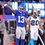 Giants wide receiver Odell Beckham Jr. signals first down after a catch and run against the Carolina Panthers on Sunday at MetLife Stadium.