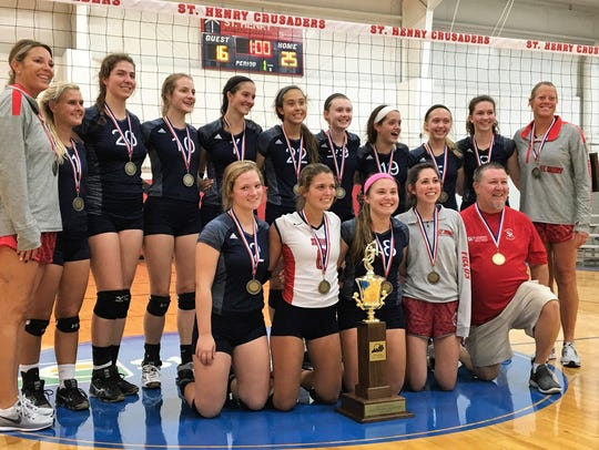 "St. Henry volleyball with its All ""A"" state championship"