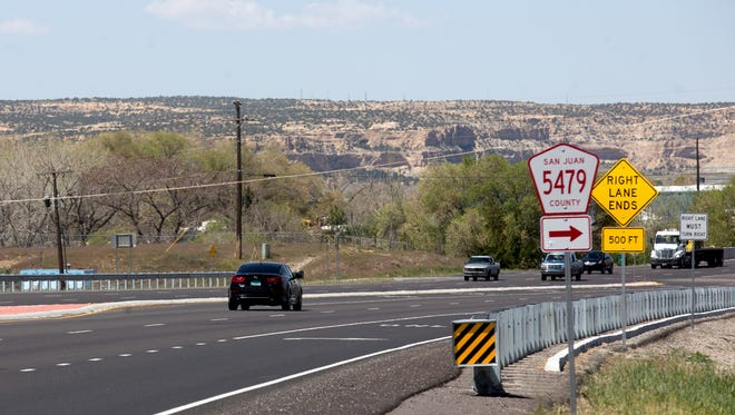 Traffic moves along U.S. Highway 64 Thursday between Bloomfield and Farmington. The final phase of a project to expand the highway between the two cities will begin soon.