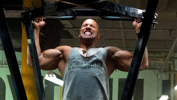 "Dwayne Johnson is a bodybuilder with drug issues in ""Pain & Gain."""