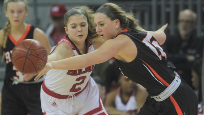Adriana Lovell of Holmes, left, and Lauren Schwartz of Ryle battle for the ball during the 9th Region girls basketball championship game between Holmes and Ryle March 4, 2018 at BB&T Arena, Highland Heights KY. Ryle won 69-41 for its first ever regional championship.