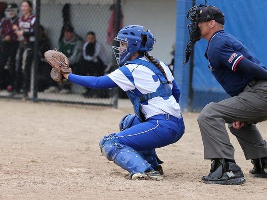 Salem senior catcher Kara Hutchison works behind the