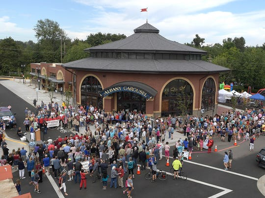 Hundreds of people young and old gathered at First Avenue and Washington Street in Albany, Ore., for the Grand Opening of the Albany Carousel.