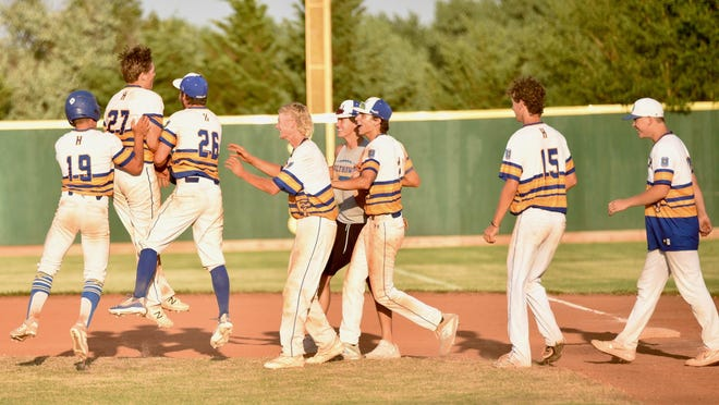 The Hutchinson Colts celebrate after a Karen Goldsmith walk off single Friday afternoon in Salina.