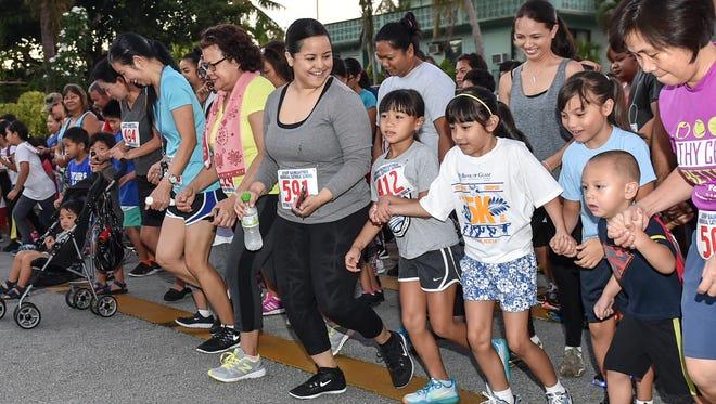 In this file photo, the 2K race gets underway at the Bishop Baumgartner Memorial Catholic School's 9th Annual Back to School 5K/2K Fun Walk/Run.