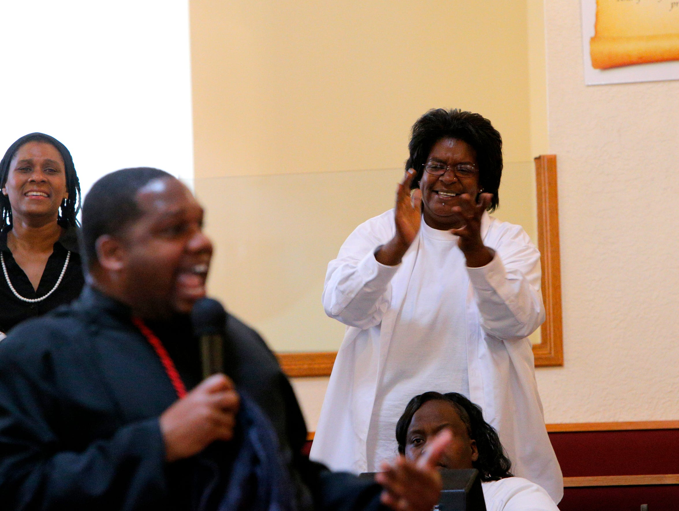 Yolanda Harraway applauds during a sermon at church.