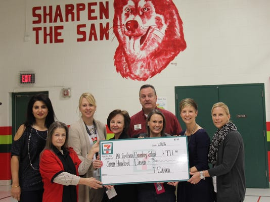 7-Eleven donation to PD Graham - 1