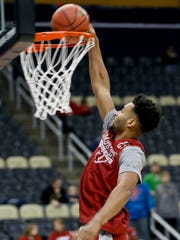 Alabama's Braxton Key goes up for a dunk during practice