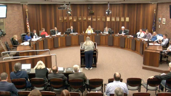 Woman speaks before Evansville City Council October 2017.