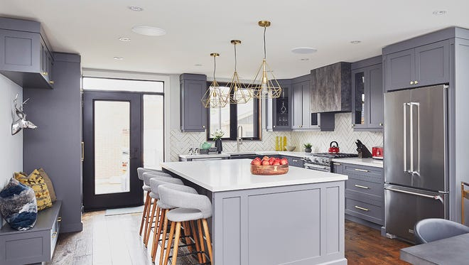 Linda Mazur designed this kitchen, using various textures to make this monochromatic kitchen interesting and restful simultaneously.