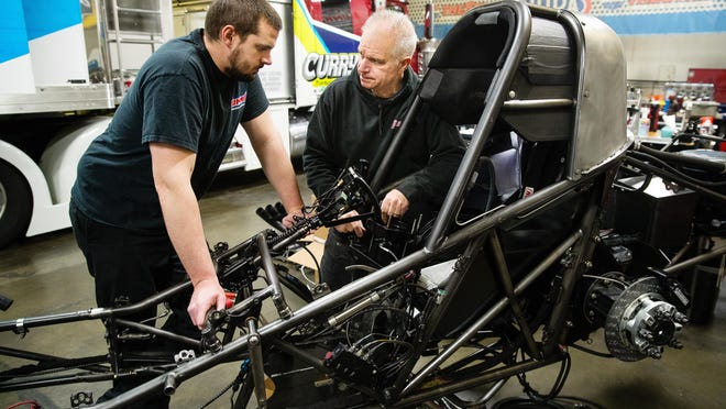 Joe Serena, left, consults with Tim Wilkerson about clutch components on Wilkerson's NHRA funny car in Wilkerson's Springfield shop Wednesday, March 25, 2020. Wilkerson can climb back into his drag racer on July 11 in Indianapolis.