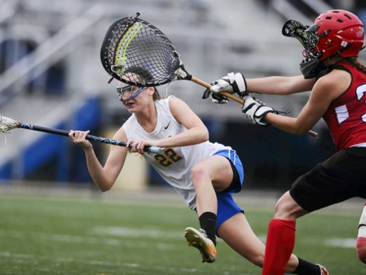 Kennard-Dale's Morgan Day, left, broke the national high school girls' lacrosse scoring record this season and was named GameTimePA.com's girls' lacrosse Player of the Year.