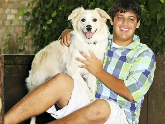 Jake Linn with his dog, Colt. Jake was killed Jan. 10, at the age of 18 when the car he was riding in crashed into a tree.