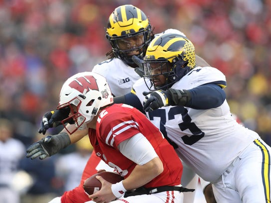 Michigan's Maurice Hurst sacks Wisconsin's Alex Hornibrook during the third quarter Saturday in Madison, Wis.