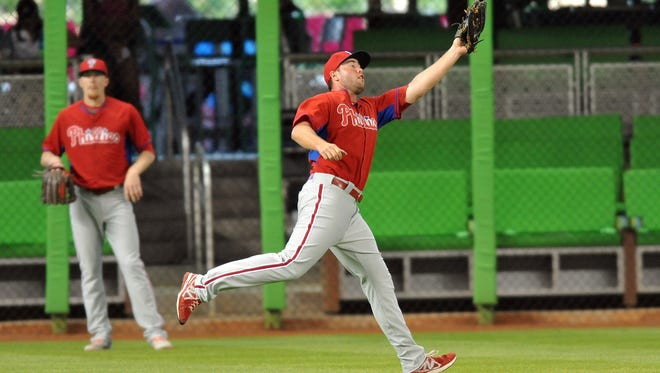 May 21, 2014; Miami, FL, USA; Philadelphia Phillies right fielder Darin Ruf (18) makes a catch in the outfield prior to a game against the Miami Marlins at Marlins Ballpark. Mandatory Credit: Steve Mitchell-USA TODAY Sports