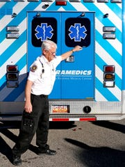 Lead paramedic John Reese closes up the ambulance doors on Monday at the San Juan Regional Medical Center Emergency Medical Services headquarters in Farmington.