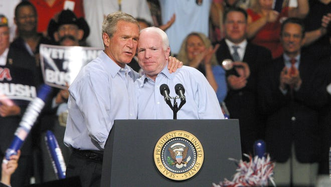 President W. George Bush and Sen. John McCain hug after McCain introduced Bush at a rally at Veteran's Memorial Coliseum in Phoenix on Aug. 11, 2004. McCain supports President Bush's Iraq policy, despite its growing unpopularity.