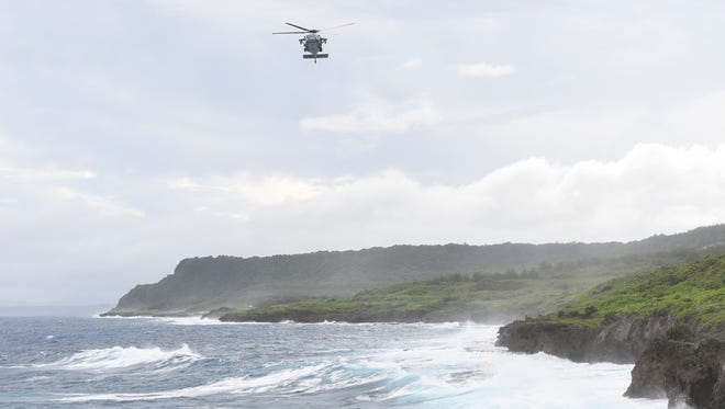 A helicopter is seen flying near Pagat Point on Nov. 20, 2016. Air Force Spokeswoman Master sergeant Farrah Kaufmann confirmed that the HSC-25 helicopter squadron, along with the Guam Fire Department, also assisted in the search for a distressed swimmer, later that afternoon.