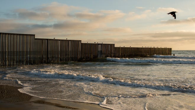 A fence separating the Mexican and American borders ends at the Pacific Ocean in Border Field State Park, San Diego, Calif. on Aug. 7th, 2017.