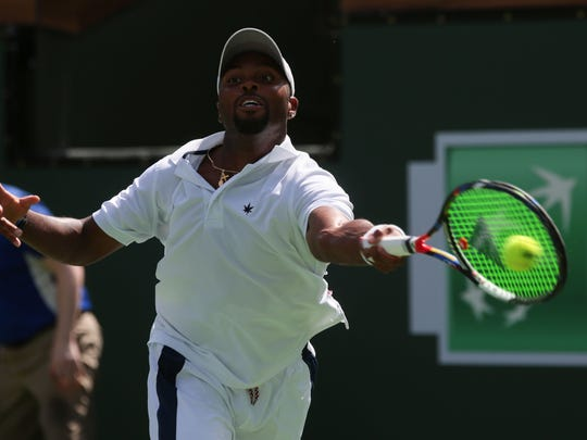 American Donald Young returns the ball to Kei Nishikori, of Japan, in the BNP Paribas Open men's 4th round Wednesday, March 15, 2017 in Indian Wells, CA.