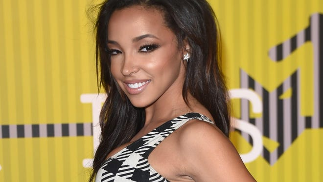 Tinashe arrives on the red carpet at the 2015 MTV Video Music Awards at the Microsoft Theater in Los Angeles.