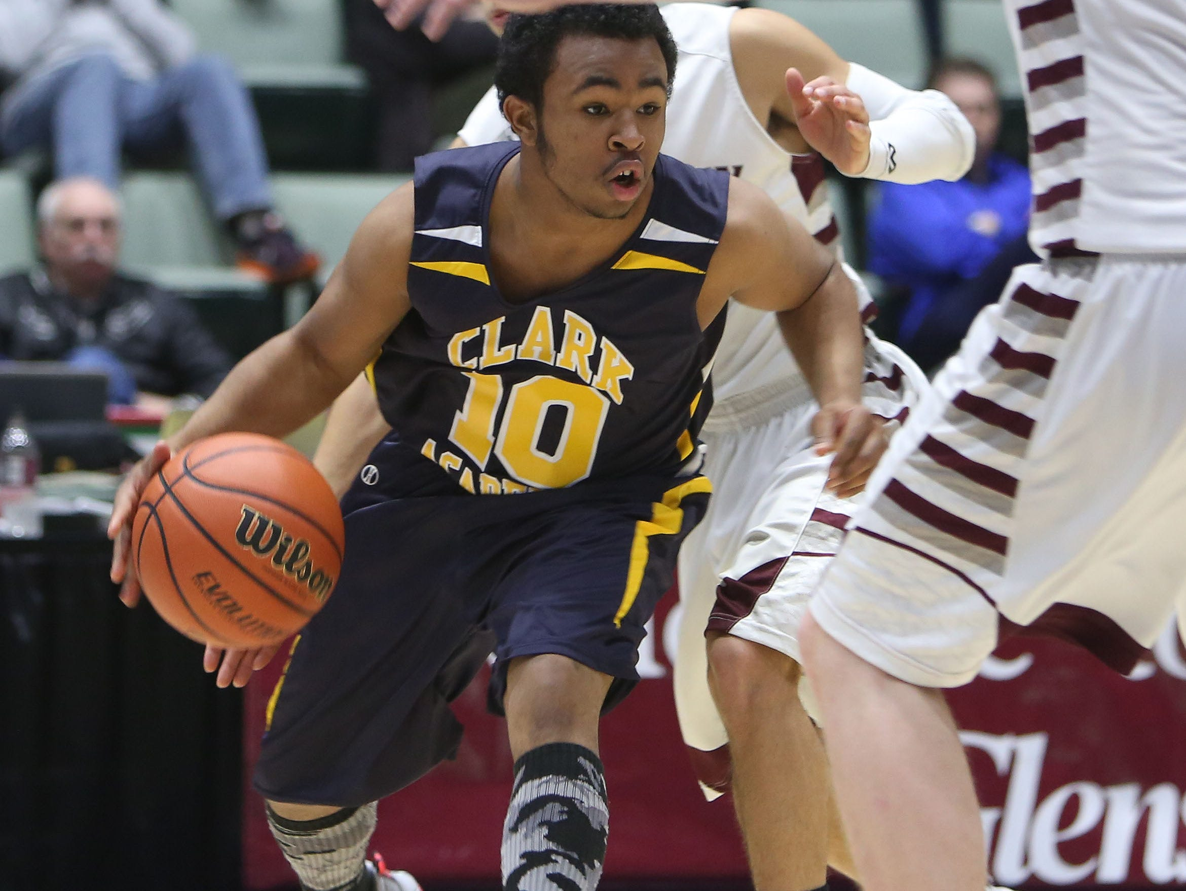 Clark Academy's Brice Banks (10) tries to drive to the basket against Oriskany during the boys Class D semifinal at the Glens Falls Civic Center March 11, 2016. Oriskany won the game 59-40.