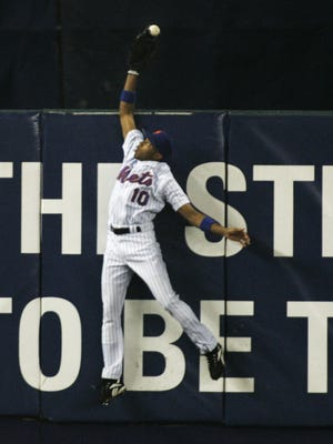 New York Mets outfielder Endy Chavez makes a leaping catch at the wall to take away a home run away from St. Louis Cardinals Scott Rolen during the sixth inning of Game 7 of baseball's National League Championship Series,  Oct. 19, 2006, at Shea Stadium in New York.