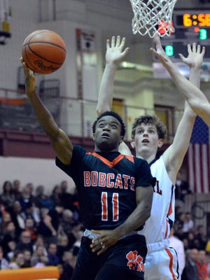 Northeastern's Fred Mulbah lays the ball up earlier this season while covered by Garrett Markey of Central York. The two teams will meet again on Friday night in Manchester. An advance ticket sale is being held for the game.
