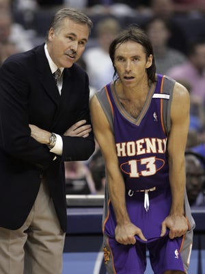 Phoenix Suns head coach Mike D'Antoni talks with guard Steve Nash in the first quarter of their first-round Western Conference playoff game against the Memphis Grizzlies.