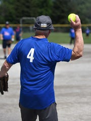 Don Limay, 84, prepares to throw a pitch back to the mound during a July 17 senior softball game.
