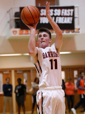 Austin Dunwoody of Harrison drains a three-point shot against Hamilton Heights Tuesday, February 20, 2018, in West Lafayette. Harrison defeated Hamilton Heights 89-76.