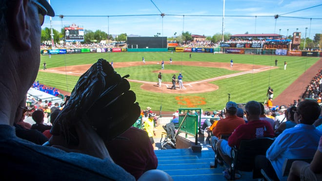 A near sell-out crowd fills Scottsdale Stadium in 2014 to watch the Cactus League baseball game between the San Francisco Giants and the Chicago Cubs.