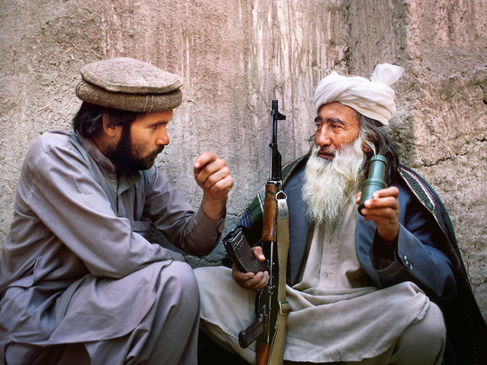 Steve McCurry Left Speaks With An Afghan Man During