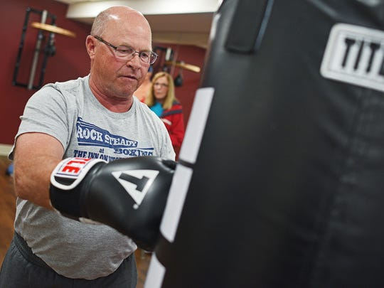 """Meldon Kroeger hits a heavy bag during a grand opening event for the Rock Steady Boxing studio at The Inn on Westport senior living community Thursday, May 18, 2017, in Sioux Falls. Rock Steady Boxing is a boxing exercise program adapted for people with Parkinson's disease. Kroeger has been attending the class three days a week since the class started in April. """"If I didn't do exercises of some sort, I'd be in a wheelchair,"""" Kroeger said. """"I'm fighting Parkinson's for what mobility I do have,"""" he said."""