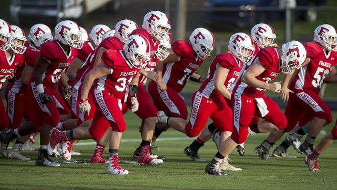 Franklin players take the field for last Friday's game against Asheville High.
