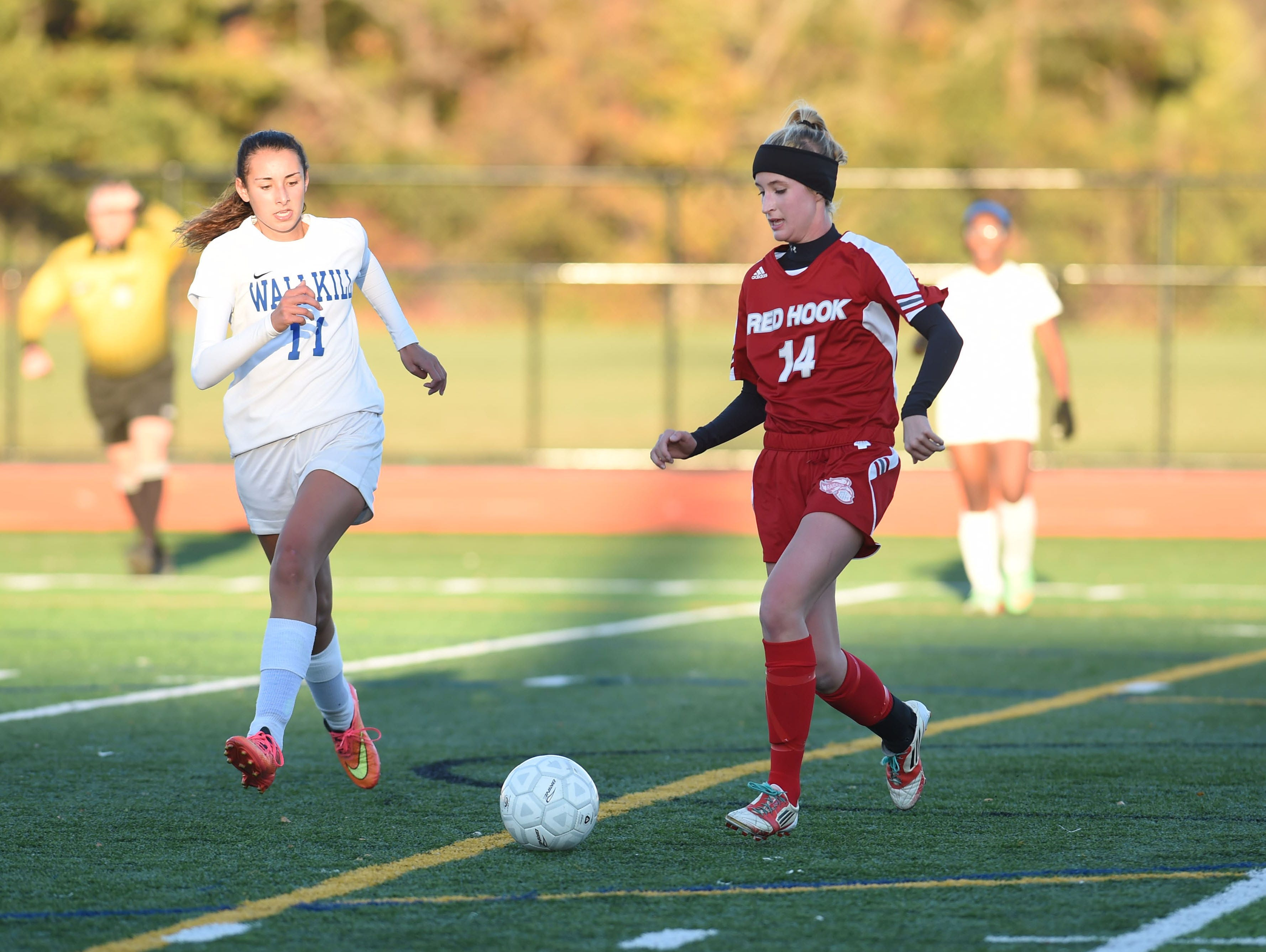 Red Hook's Claire Dyal, right, takes the ball downfield against Wallkill during the MHAL semifinal game at Franklin D. Roosevelt High School last year. Red Hook and Wallkill will meet again in the MHAL semifinals on Monday.